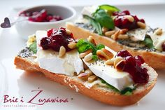 Sandwich with brie chees, cranberry and pine nut