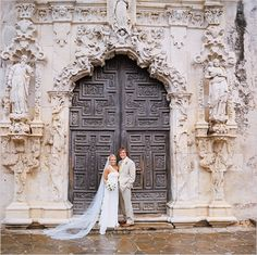 This couple poses in front of The historic Mission San Jose church for their Mexican style wedding that took place in the historic Mission San Jose, downtown San Antonio, Texas.