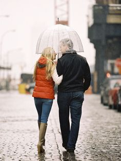 Worried it'll rain on your engagement photo day? Be prepared and use the stormy weather to your advantage. A dark, stormy sky with some rain can actually make for a dramatic but ultra-romantic setting. Play up the rainy day theme with a cute umbrella, Wellies (like this girl did), and a colourful raincoat.     Photo via  Braedon Flynn Photography .