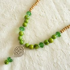 Brazilian Green Acai Seeds, Green Czech Crystals, Wood Beads and Silver Spacer Eco Friendly Necklace via LauraBijoux. Click on the image to see more!