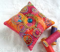 Color Me Happy Pincushion, hand embroidered, patchwork.