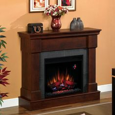 Franklin Brown Cherry Electric Fireplace Convertible Mantel Package - Furniture quality materials for a beautiful living room upgrade http://www.electricfireplacesdirect.com/products-accessories/electric-fireplace-mantel-packages/Franklin-23-Roasted-Mahogany-Electric-Fireplace-Cabinet-Mantel-Package