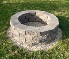 DIY Firepit. Love the gravel around it, but after reading the comments I would agree that making the gravel circle larger would be better/easier for mowing. Blogger gave size as outer pit being 4ft diamter, 4 rows high and using 52 stones with 4cu ft of pebbles.