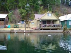 Deer Lake Waterfront Home 54' frontage, 3 bedrooms (non-conforming), 1 bath, 1090 sq ft, partially furnished, excellent lake views from the family room, covered deck overhanging lake, fenced yard, level waterfront.