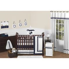 Make your baby's new home as cute as can be with this gender-neutral JoJo Designs nine-piece baby crib bedding set. This set features a charming navy and white color palette and 100-percent construction, ensuring your nursery is comfy and welcoming.