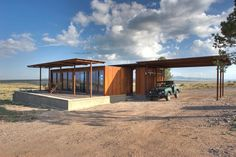 A Petite Prefab With Stunning Views of the Texas Landscape - Photo 1 of 8 - The house has two modules: a living space on the left and a utilities, laundry, and outdoor kitchen on the right.