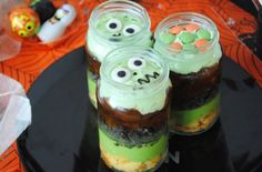 These terrifying Halloween trifles are going to be the talk of your Halloween party! Made in nifty jars, each layer is a gruesome twist on a classic trifle. From green custard to orange jelly, these trifles are sure to please your kids! You can cheat and use ready-made foods or make your own - it is entirely up to you! Throwing a Halloween party this year? Check out the rest of our Halloween party food ideas here!