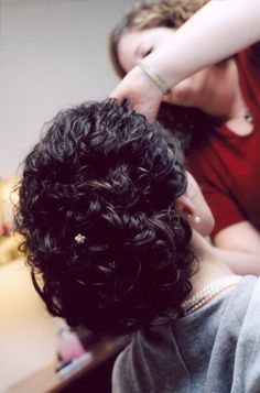 Naturally curly updo.                                                                                                                                                                                 More