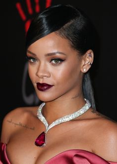 Rihanna accentuates her best assets with an eye-catching pendant necklace.