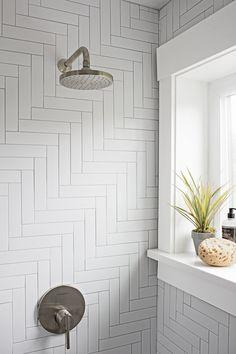 Driftwood-look storage, herringbone-stacked tile, and more keep the eye wandering