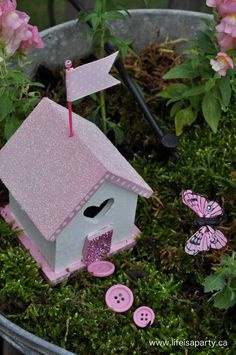 Pink fairy garden house with button stepping stones - More enchanting photos of this magical FAIRY GARDEN on The Magic Onions Blog and FairyGardens.com