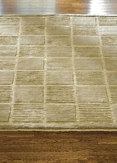 Bring dimensional character and style to any room in your home with the Tibetan Tiles Wool Area Rug in Kiwi; hand-knotted in Tibet of ultra-soft Tibetan wool.