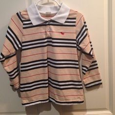 Striped kids shirt Cream long sleeve collared top with black, white, and red stripes and 2 buttons. Says size 7 but runs small. Will fit most 5 or 6 year olds. Shirts & Tops
