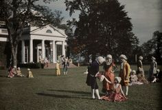 1928. US.  A large group of actors, a rest and talk on the lawn at Monticello, Virginia