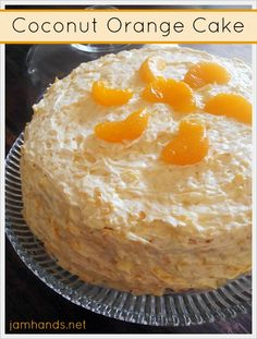 Coconut Orange Cake Recipe ~ a moist orange and coconut cake is frosted with even more orange and coconut. It is divine!