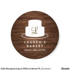 Cake Monogram Logo in White on Brown Woodgrain
