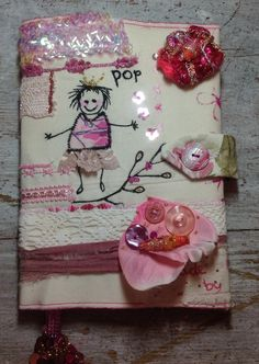 notebook, made of fabric, tyvek, lace, stamps, embroidered, painted. beads and buttons.