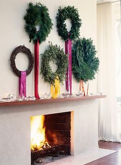 Five wreaths above fireplace