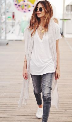 White t-shirt, dainty necklaces, and sneakers