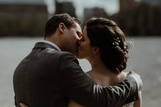 Bride and Groom kiss overlooking the River Thames in London. City style wedding.