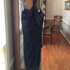 NWT Exquisite navy dress❤️❤️❤️ Be the belle of the ball in this dress!!!!!  Made in China. Shell/exterior is 100% Polyester. Lining is double 100% Polyester.  Hard to show the beautiful details of this dress because it is such a dark navy Badgley Mischka Dresses Prom
