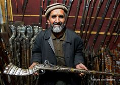 Sher Mohammed holds a replica jezail musket in his shop in downtown Kabul Jezails, which were originally handmade by Afghans during their fight against the British in the 19th century, have survived along with other antique guns as a popular souvenirs for American servicemembers. (PHOTO BY JOSH SMITH/STARS AND STRIPES)