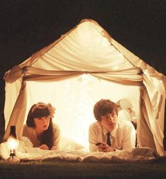 """NEW TREND - glamping, or glamorous camping, which is all the rage. Whether indoors or out, pitch a beautiful tent to create the ultimate lair of love. """"Fill it with pretty string lights, your favorite bites, and soft fabrics, and pretend that you're anywhere else but at home."""""""