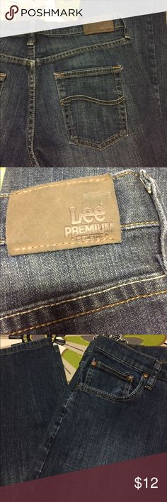 Lee Premium Boys Size 14 Husky jeans Jeans have an adjustable waist. See photo of adjustable elastic and buttons.  Waist is about 15 inches across and the inseam is 27 inches long. Dark wash jeans Lee Bottoms Jeans