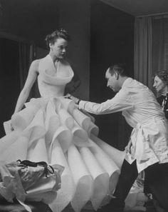 Antonio del Castillo fits a model, 1951. Photograph by Nat Farbman for LIFE Magazine.