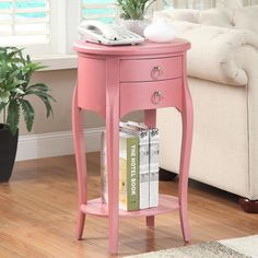 Display decorations or store personal items with this pretty pink Ashton side table,decorated with elegant curved legs.  Made of solid wood and MDF,this charmi…