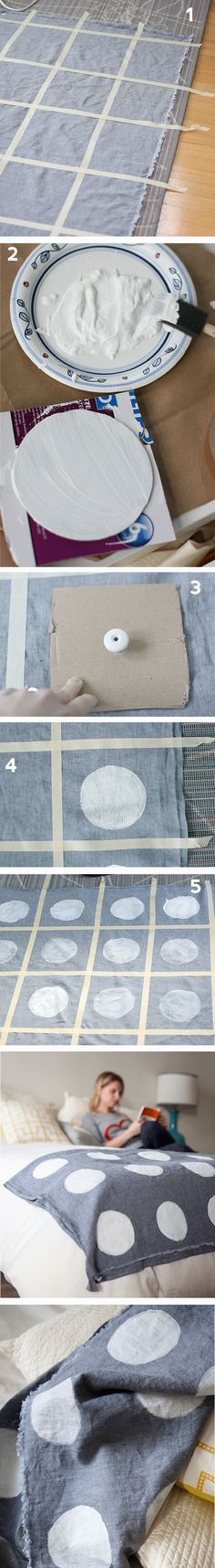 Hand stamped polka dot coverlet DIY.  All you need is linen, white fabric paint, paint or foam brush, scrap cardboard or styrofoam brush, masking tape, and time!  Love, love, LOVE polka dots!!