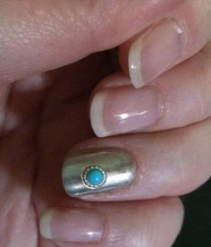 My Navajo Nails. Chrome powder over grey gel, silver circle frames from WiiNo Shop, and tiny turquoise resin half pearls.  https://www.wiinoshop.com/collections/nail-art-nail-decor/products
