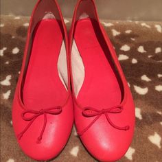 Classic leather J. Crew ballet flats Gorgeous coral ballet flats. Great condition, one shoe has tiny mark (shown in photo) that could be removed with leather cleaner. J. Crew Shoes Flats & Loafers