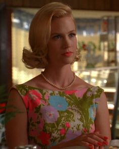 January Jones as Betty Draper, hair, lipstick, dress and nails.