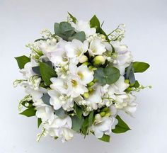 White Freesia, White Lily Of The Valley, Green Hypericum Berries, Green Eucalyptus Wedding Bouquet