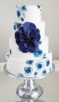 Hand painted flowers with over-sized sugar flower wedding cake