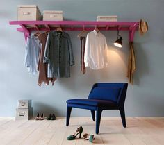 5 Unusual & Modern Ways to Display Your Clothes at Home - Another DIY ladder reuse-able idea! This time you use an old ladder with paint and install it in such a way that you have storage above and below. Seen on Living Corriere.