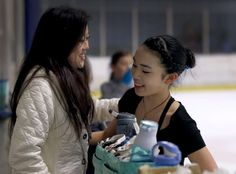 Olympic gold medalist Kristi Yamaguchi meets with current United States figure skating champion Karen Chen during a training session at the Sharks Ice skating rink in Fremont, Calif. on Saturday, March 11, 2017. Yamaguchi has been mentoring the 17-year-old Chen, who will be competing in the world championship in Finland beginning March 29.