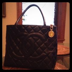 Authentic Chanel Purse Authentic Chanel Purse. 2007/2008, Chanel Revival Medallion Black Tote. 12x6x10 perfect condition!  Only serious offers!! CHANEL Bags