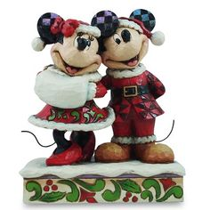 """Jim Shore Disney Traditions 2012  SANTA MICKEY & MINNIE MOUSE    Harking back to Irving Berlin's White Christmas, Jim Shore creates a beautiful duet with Mickey and Minnie dressed in their seasonal finest.    Specifications:  Size: 6""""H x 3.25""""W x 4.75""""L  Materials: Stone Resin  Introduced: January 2012  Note: Unique variations should be expected; hand painted    Your Price: $47.50"""