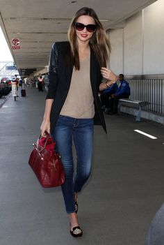 The Best Model-Off-Duty Looks (Updated!): Helena Christensen topped her jumpsuit with a denim jacket, then finished with ballet flats and a tan bag in NYC.  : Miranda Kerr created a travel look with cropped Frame Denim and edgy touches via a leather-sleeved blazer, a rich red Viktor & Rolf bag, and velvet loafers.