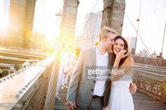 Stock Photo : Young couple on Brooklyn Bridge at sunset