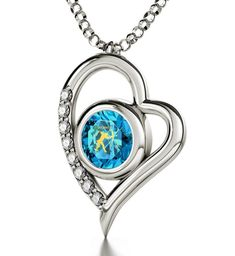 "925 Silver Zodiac Heart Pendant Sagittarius Necklace Inscribed in 24k Gold on Blue Swarovski Crystal, 18"". Silver heart shaped necklace with Sagittarius star sign and symbol intricately inscribed in 24k Gold using innovative technology onto a brilliant round cut 0.3 inches, 8mm blue colored Swarovski crystal, the birthstone color of December. A 925 sterling silver, high quality, Italian chain measuring 18 inches, 45cm, elegantly suspends from the romantic heart pendant, 0.8x0.6 inches..."