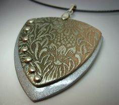 Golden floral pattern polymer clay pendant by PollyMirabilis