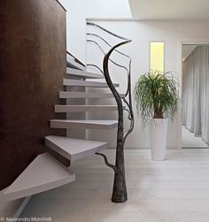 A Tree-Like Sculpture Acts As A Railing For These Stairs