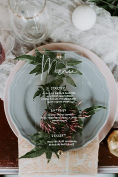 This clear acrylic wedding menu adds a modern twist to this botanical wedding table setting | Image by MLE Pictures