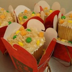 Chinese themed party cupcake favors..square cupcake, loose rice crispies, green and yellow skittles and piece of orange something for carrots