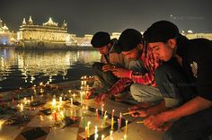 Diwali Festival of Lights -  India....The entire edge of the pond was lit with countless oil lamps and candles, each offered by a pilgrim celebrating the festival of lights, the victory of light over darkness.""