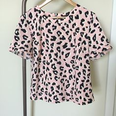 Pink leopard print top This is an attention grabbing shirt featuring a super cute leopard print! It's slightly bigger on me that's why I'm letting it go. I was so in love with it I HAD to have to... But ended up not wearing it much. It's only worn 1-2 times so still in pristine condition! Polyester material and perfect for the summer! W5 Tops