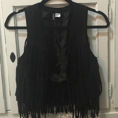 Black H&M Fringe Vest Barely worn. H&M size 4. Fits a bit smaller than your typical size 4.. more like a 2. Adorable and great quality! H&M Jackets & Coats Vests